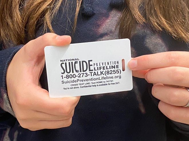 Student ID cards for middle and high school students across Michigan now include suicide prevention hotline information.