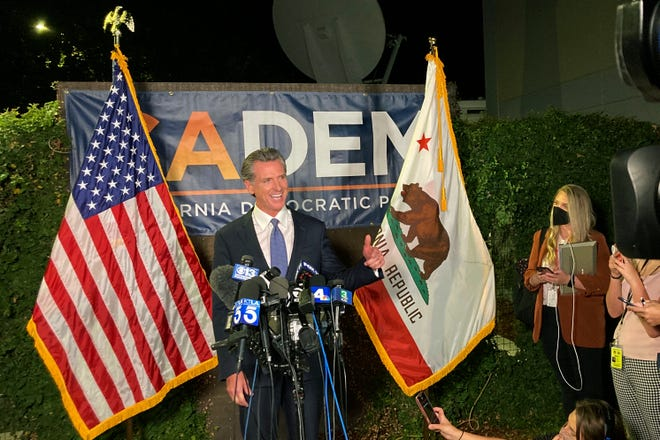 Gov. Gavin Newsom addresses a crowd in Sacramento, Calif., on Tuesday night, Sept.14, 2021. Newsom defeated an attempt to oust him from office, overcoming Republican criticism of COVID-19 restrictions that shuttered schools and businesses. (AP Photo/Rich Pedroncelli)