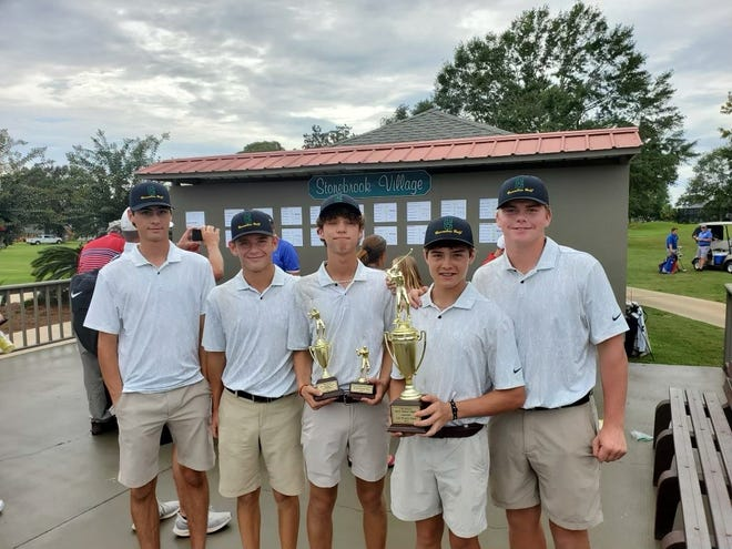 The Pensacola Catholic boys golf team poses for pictures after winning the Byron Nathan Memorial Tournament on Monday, Sept. 13 from the Stonebrook Golf Course.