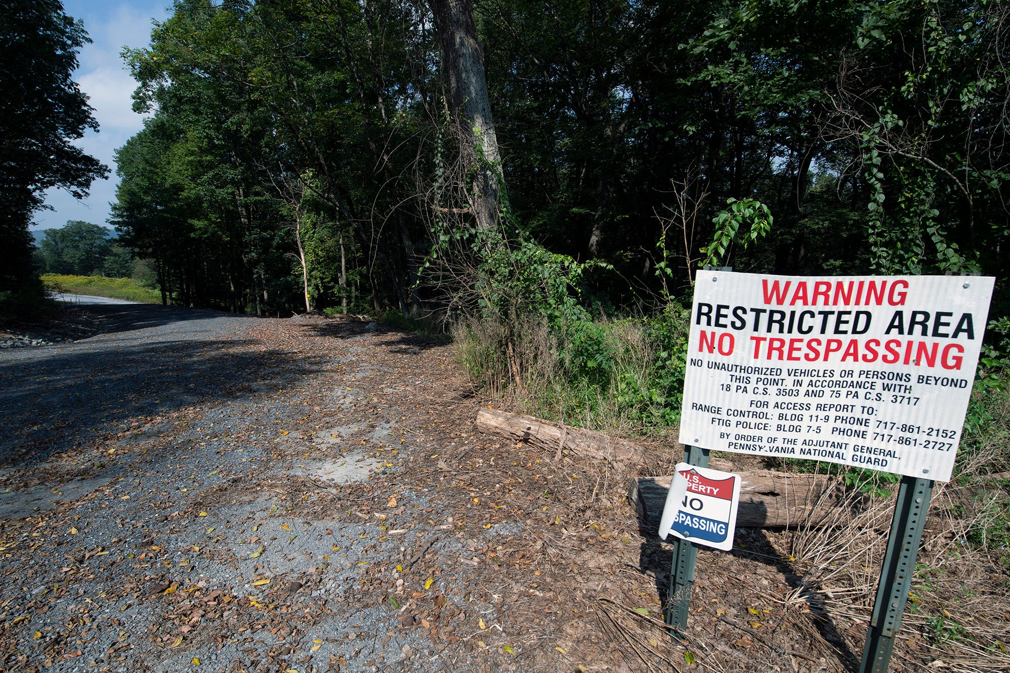Christi Daubert believes the unidentified girl was found just beyond this sign on Tomstown Road on the edge of Fort Indiantown Gap.