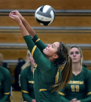 Bishop Manogue's Sydney Tripp hits a return to the McQueen Lancers during Tuesday's game at McQueen. Bishop Manogue won 3-0.