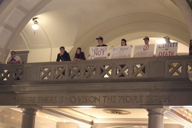 Protestors rallying against federal vaccine orders gathered in the rotunda of the Missouri State Capitol on Sept. 15, 2021.
