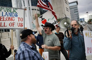 In this Feb. 6, 2017, file photo, supporters and critics of defenders of Cliven Bundy, who was on trial over an armed standoff with federal prosecutors gather at the federal courthouse in Las Vegas.