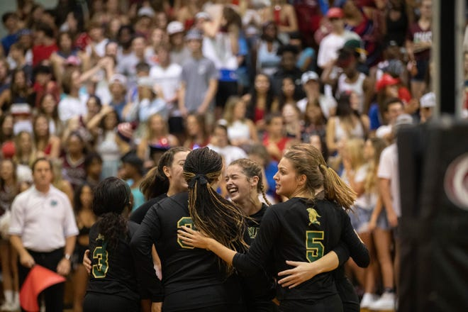 The Lincoln team celebrates during a game between Lincoln and Chiles at Chiles Tuesday, Sept. 14, 2021.