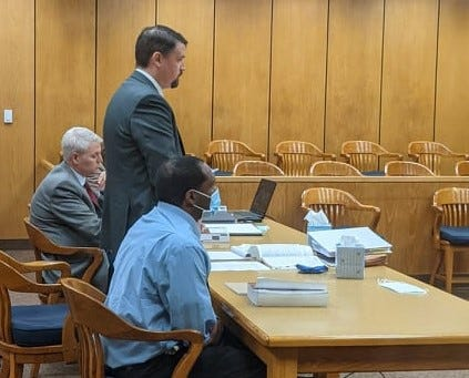 Court-appointed defense attorney Carey Jensen, standing, questions Wichita Falls police investigator Walter Vermillion Tuesday, Sept. 14, 2021, during the child sexual assault trial of Christopher Lynn Petty, seated right. Wichita County District Attorney John Gillespie, seated left, listens to the proceedings.