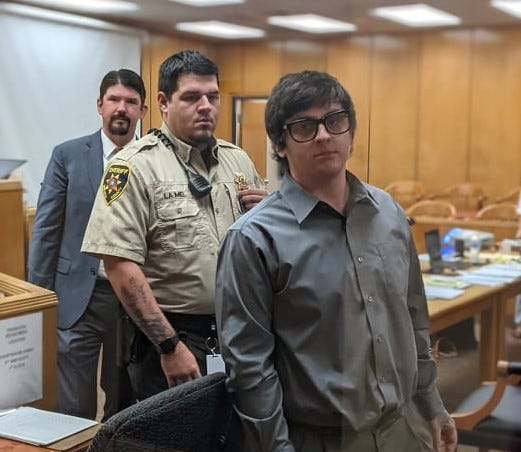 Defendant Adam Hammond, right, leaves 89th District Court Wednesday, Sept. 15, 2021, after a day at trial. A Wichita County sheriff's deputy and Hammond's court-appointed defense attorney Dustin Nimz are behind him.