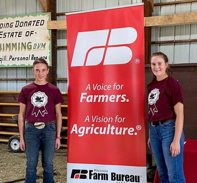 Overall Master Showman Contest Winner at the Iowa County Fair are Joey Robinson, Mineral Point and runner-up Julia Searls, Cobb.