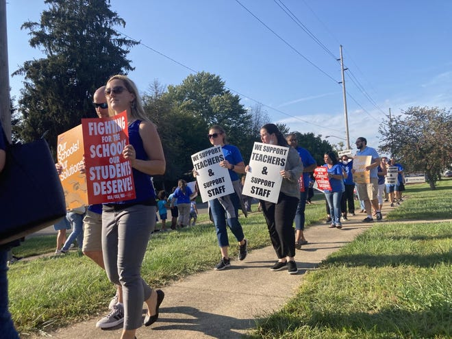 Dozens of Zanesville Education Association members and supporting community members rallied outside the Zanesville City Schools administrative office Tuesday evening after four months of teachers contract negotiations.