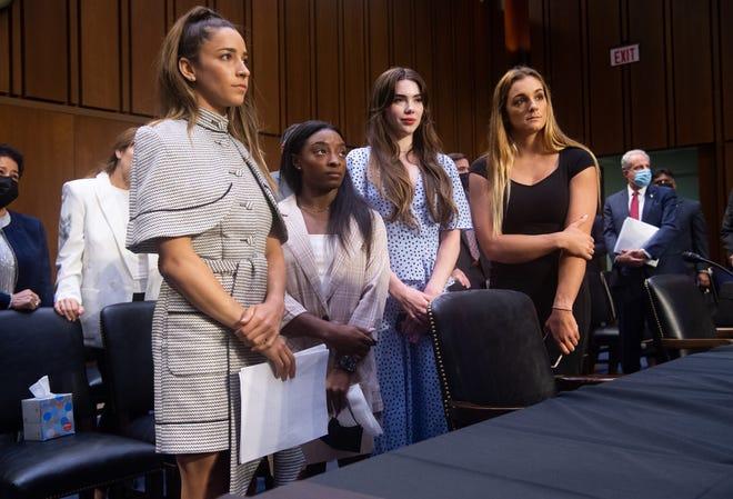 U.S. gymnasts Aly Raisman, Simone Biles, McKayla Maroney and NCAA and world champion gymnast Maggie Nichols leave after testifying during a Senate Judiciary hearing on Wednesday.