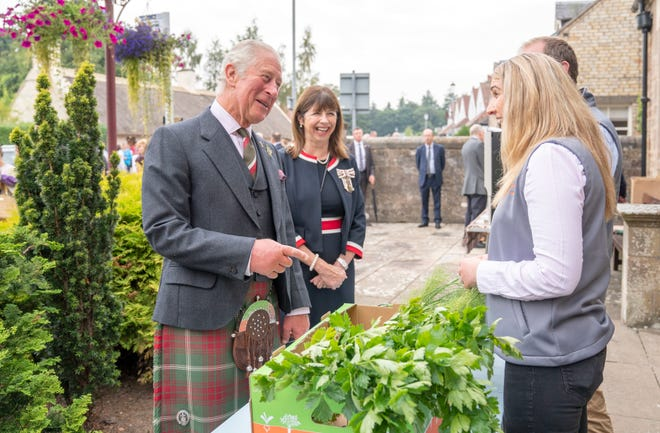 Prince Charles meets with food and craft producers outside the Village Hall during a visit to Alloway Main Street and Robert Burns' Cottage on Sept. 8, 2021 in Alloway, Scotland.
