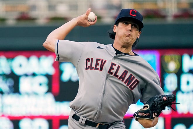 Cleveland pitcher Cal Quantrill throws to a Minnesota Twins batter during the first inning of a baseball game Wednesday, Sept. 15, 2021, in Minneapolis. (AP Photo/Jim Mone)
