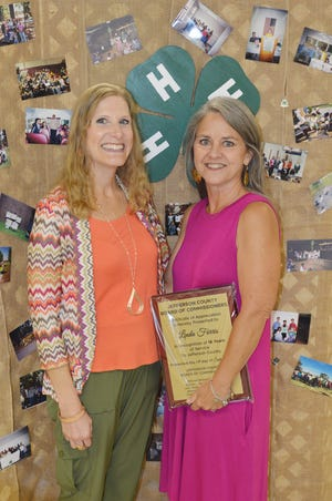 Linda Davis Farris (at right) poses with Kelley Newberry (at left), Jefferson County's new 4H coordinator.
