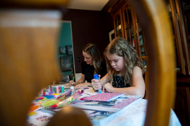 Sedona Orlow, 9, and Rachel Bennett work on greeting cards in Bordentown.