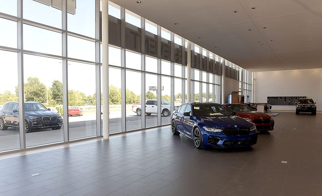 The showroom at BMW of Columbia is usually full of new cars, but a shortage of computer chips has caused auto makers to fall behind on sending inventory to dealers.