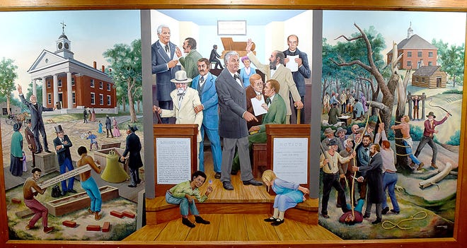 A mural painted by Sidney Larsen in 1994 is one of two that have adorned the walls of the Boone County Courthouse. The Boone County Commission has voted to take them down.
