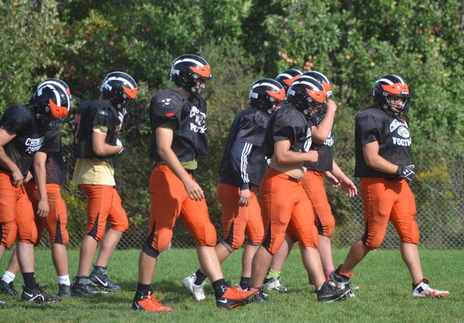 Cheboygan players walk together during a team practice on Wednesday, Sept. 8. Cheboygan will take on rival Sault Ste. Marie at Western Avenue Field on Friday night.