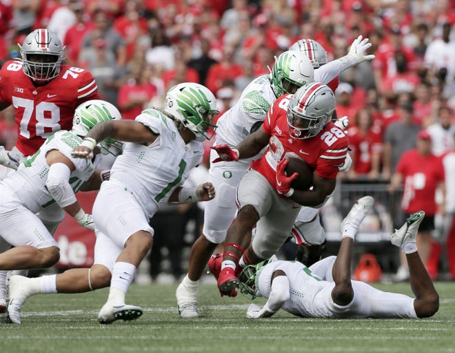 Running back Miyan Williams ran for 77 yards as the Buckeyes posted 128 rushing yards against the Ducks, the fewest in coach Ryan Day's tenure.