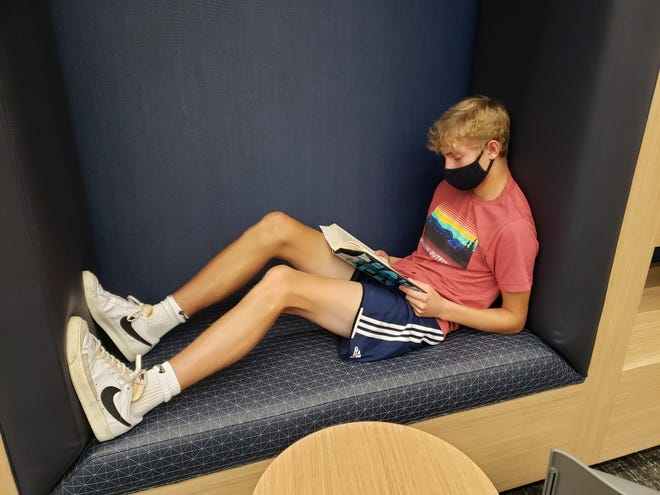 Grandview Heights High School sophomore Jaylen Brown enjoys a book Sept. 15 in one of the reading nooks that are part of the media center in the new Larson Middle School building. The high school's students and staff are occupying the new building while their school is undergoing  interior renovation.