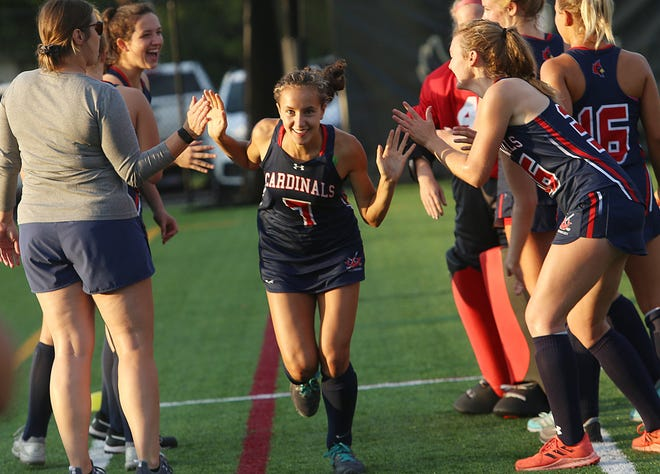 Thomas' Leila Boussedra takes the field before the Cardinals' field hockey game at Watterson on Sept. 15. Following the death of her stepfather this summer, Boussedra is having standout seasons in field hockey and cross country.