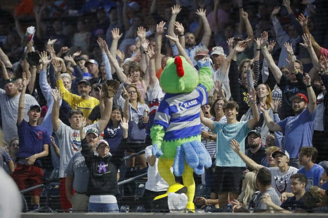 Columbus Clippers mascot Krash fires up the capacity crowd during a game against the Toledo Mud Hens in June. Health experts say people need to determine the risk they're comfortable with when attending events such as a baseball game. Outdoor events were people are socially distanced are safer, they say.