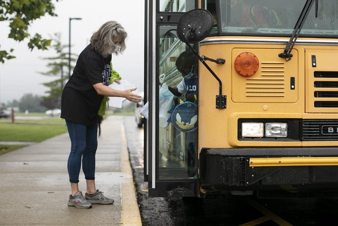 Vicki Westwood, a teacher at Pickerington Elementary School, greets students on the first day of school Aug. 16. Like last year, the district is struggling to find an adequate number of bus drivers to cover its 64 routes.