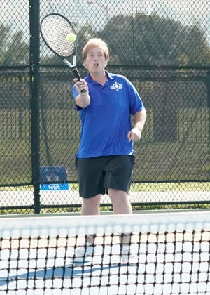 Adrian's Hunter Davies returns the ball during a match at No. 1 doubles against Tecumseh on Wednesday at Adrian College.