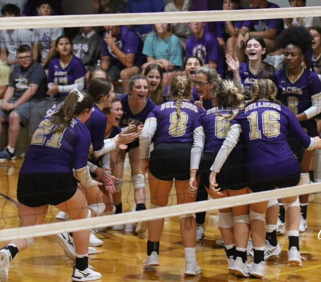 Ascension Catholic celebrates during a three-set victory over Brusly.