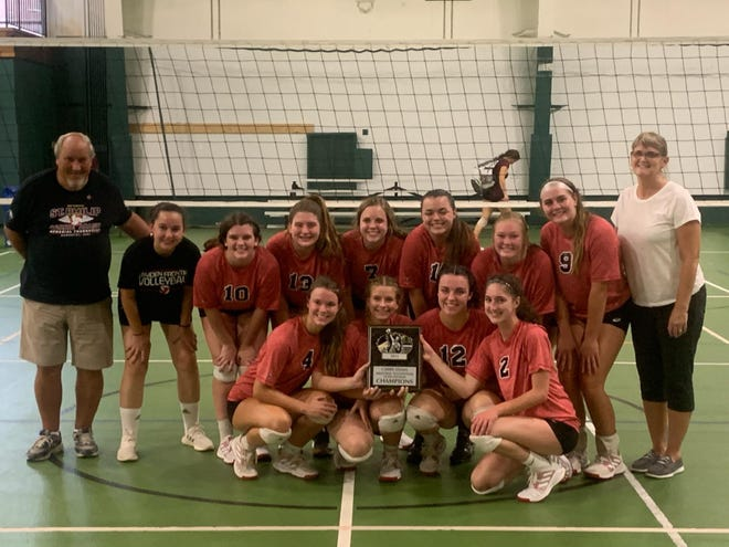 Pictured; The Camden-Frontier 2021 Fall Volleyball team after their Silver Pool Championship at the St. Phillip Carrie Adams Tournament. Carrie Adams' father is left, head coach Dawn Follis is to the right.