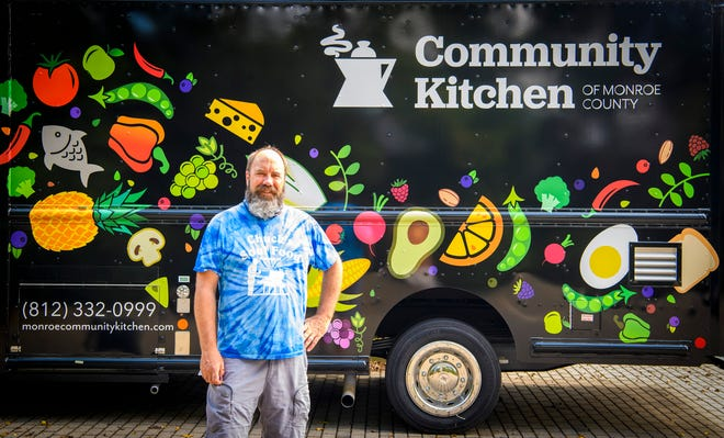 Tim Clougher stands next to the new Community Kitchen food truck on Thursday, Sept. 16.
