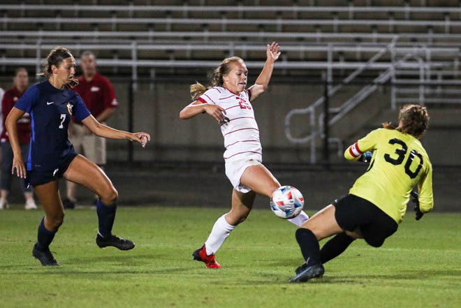 Indiana's Paige Webber (25) hits a shot past Murray State goalkeeper Jenna Villacres (30) during IU's 4-0 win at Armstrong Stadium on Sept. 9, 2021. It was the third goal of the night as Webber finished with a hat trick, her first goals as a Hoosier.