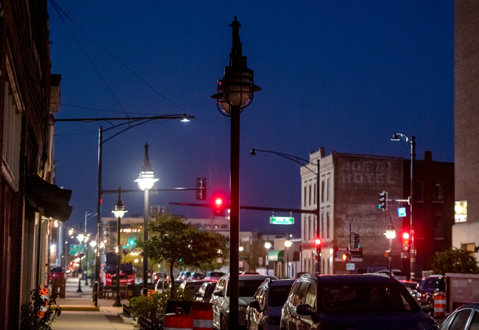 A street lamp stands dark along Southwest Adams Street in Peoria's Warehouse District.