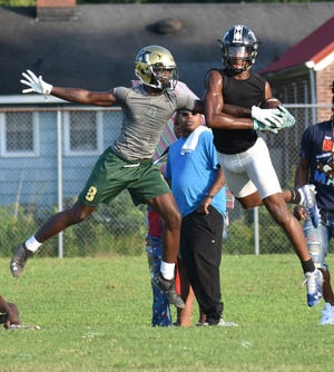 Kinston High football and its Lenoir County rivals are again in the same conference, but have stiff competition from traditional Duplin County powers, for the next four years. KAYE NESBIT/FOR THE FREE PRESS