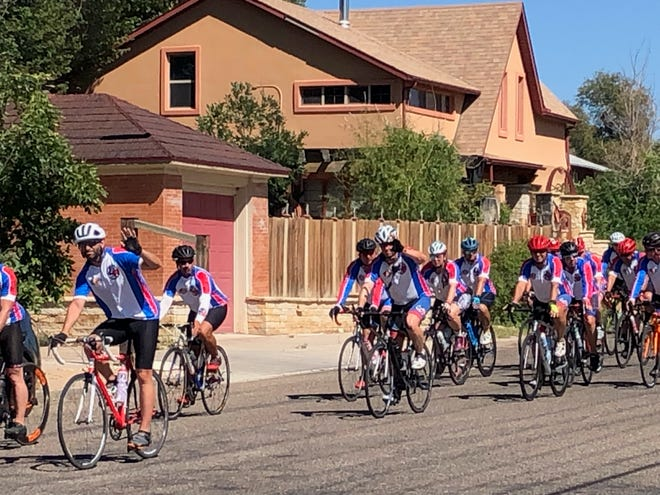 Cyclists on the Texas Brotherhood Ride to honor fallen first responders ride West along 6th Street in La Junta between Raton and Colorado Avenues Wednesday afternoon.