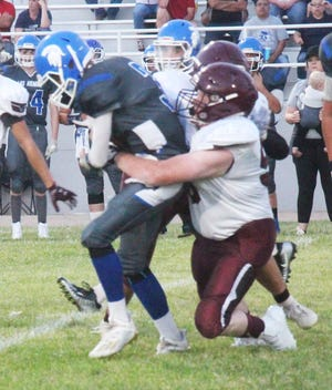 Swink High School's Clay Roweth (5) tackles Las Animas' Caden Morlan in a game played on Sept. 3. Swink hosts Dolores Huerta on Friday, Sept. 17, while Las Animas hosts Hoehne also on Sept. 17.
