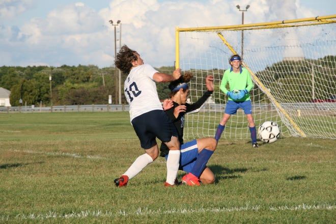 Jaiden Nason of Airport (10) gets tangled up with Jefferson's Michael Armetta in front of the net Wednesday. Airport earned a 5-1 win over the Bears.