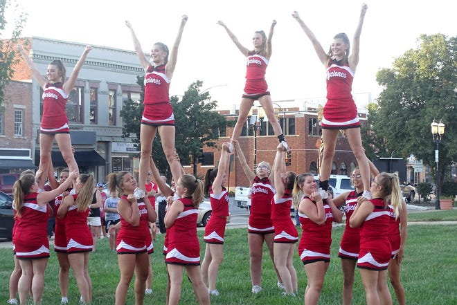The Ottawa High School cheerleaders put the finishing touches on their routine at the homecoming parade/block party.