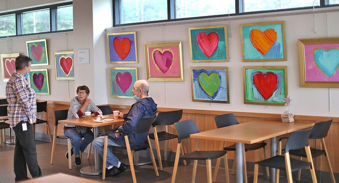 Hearts by Max, paintings created by artist Max Boehme, are on display at the Cushing Café in Hanover on the campus of the Cardinal Cushing School on Thursday, Sept. 16, 2021.