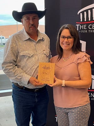 Boyd Farmer received an award for the positive impact he has had on tourism in the region. He is pictured with Tonya Fletcher, president of the Arkansas River Valley Tri-Peaks Tourism Association.