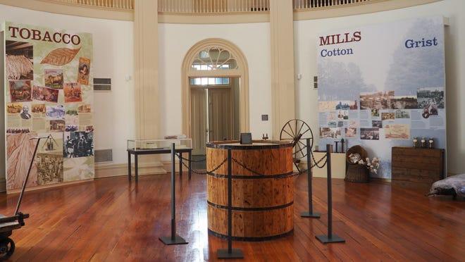 The main exhibit 'Pillars of Commerce' on display inside The Exchange Building's rotunda in Old Towne Petersburg.