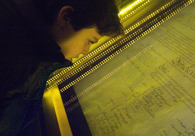 A student views the original Constitution at the National Archives in Washington, D.C.