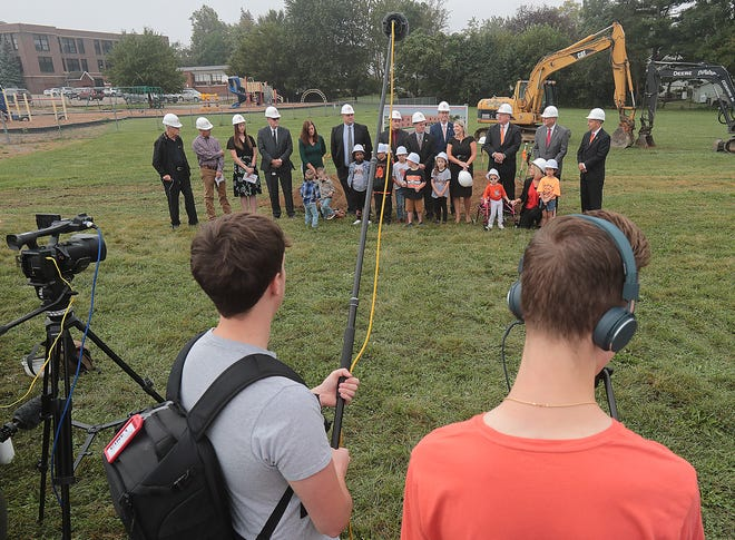 School, community and government officials joined students in a groundbreaking ceremony Thursday for the district's new primary building that will house students in preschool through second grade.