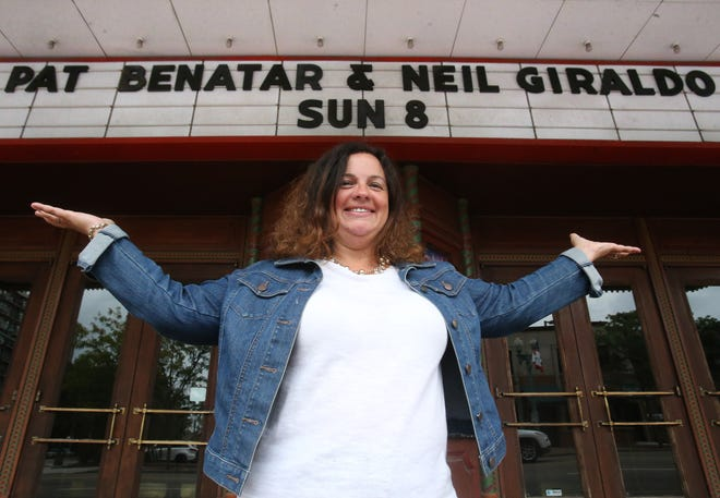 Georgia Paxos is shown with the marquee for the Pat Benatar and Neil Giraldo concert at the Palace Theatre in Canton. Proof of a full COVID vaccination or a negative COVID test result will be required for entry. Paxos is the executive director of the venue.