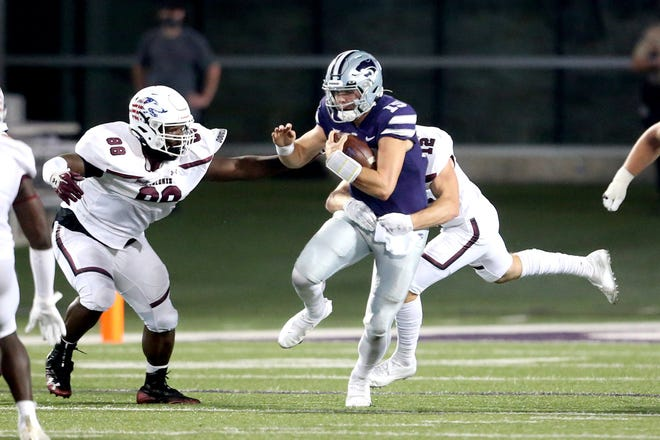 Kansas State quarterback Will Howard (15) is tackled by Southern Illinois'  Branson Combs (12) and Gianini Belizaire (88) during last week's game at Bill Snyder Family Stadium. Howard will start in place of the injured Skylar Thompson against Nevada on Saturday.
