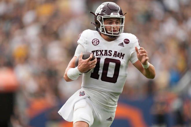 Texas A&M quarterback Zach Calzada runs for a short gain against Texas A&M in the second half of an NCAA college football game on Sept. 11 in Denver. Texas A&M won 10-7.