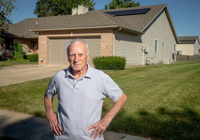 """Jim Custer had a 2.28kW solar power system installed on his home earlier these year mainly because he was concerned about the environment, but for economical reasons as well. """"I believe in global warming and I think we contribute to it,"""" said Custer. His system thus far has produced enough energy that his electric bill has been negligible since it was installed. """"I think it's an excellent deal, I got it initially because I was concerned about the environment and costs going down the road. I like it, it works well and I haven't had any hassle with it."""" [Justin L. Fowler/The State Journal-Register]"""