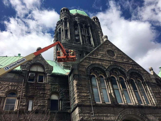 Workers perform emergency roof repairs at the Superior Courthouse in Taunton in this 2018 file photo.