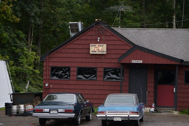 A large movie reflector is visible at left adding light to the side of the B-Man's 140 Tavern. Today it was effectively transformed into a '70s bar named Dell's on Sept. 16.