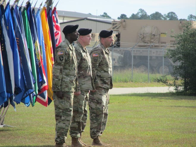 From left to right, Command Sgt. Maj. Quinnis Caldwell, the incoming senior enlisted advisor for the 108th Air Defense Artillery Brigade, stands alongside brigade commander Col. Marc Pelini and outgoing Command Sgt. Maj. Daniel Hillburn during a Sept. 10, 2021, change of responsibility ceremony at Fort Bragg.