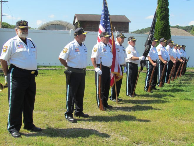 """The """"Day of Remembrance and Recognition"""" concluded with the playing of """"Taps"""" and a 21-gun salute by the Honor Guard of Newcomerstown American Legion, Thomas C. Montgomery Post 431."""