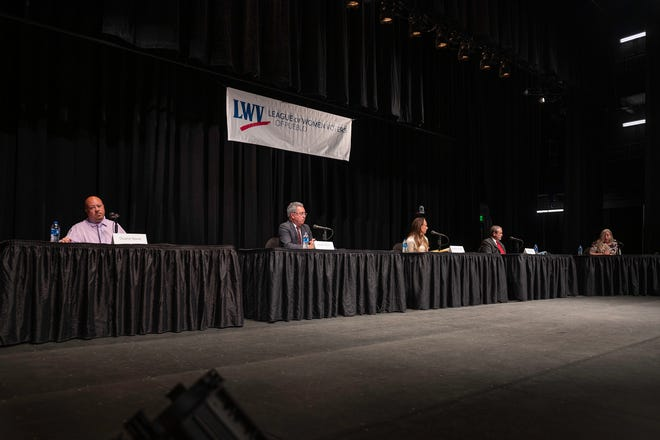 Candidates for Pueblo City Council at-large, from left, Duane Nava, Dennis Flores, Heather Graham and Mark Aliff participate in a forum moderated by Sara Blackhurst, right, Wednesday September 15, 2021 at Pueblo's Memorial Hall.